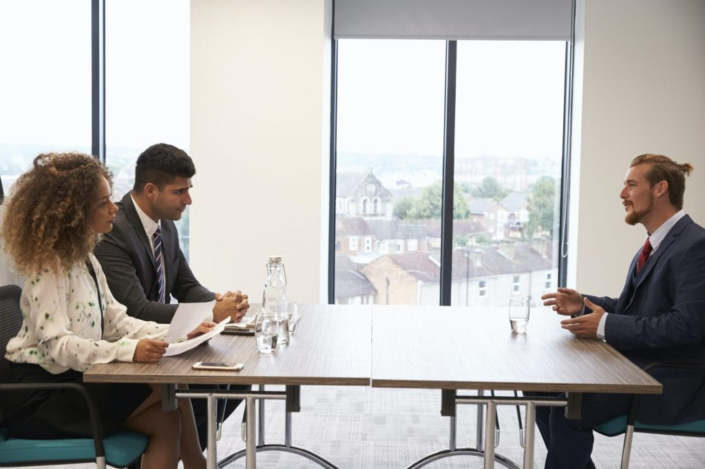Male Candidate Being Interviewed For Position In Office