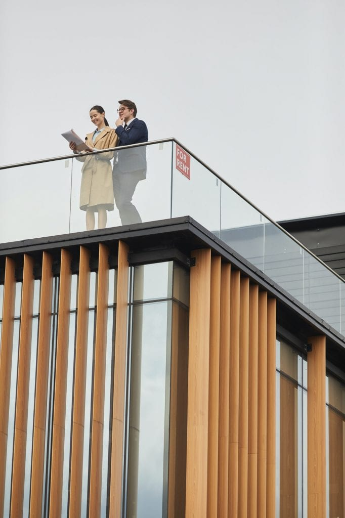 Two Real Estate Agents Standing on Roof
